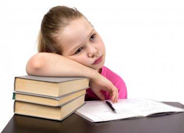 The schoolgirl does homework