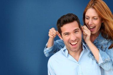 Woman pulling on her boyfriend's ears