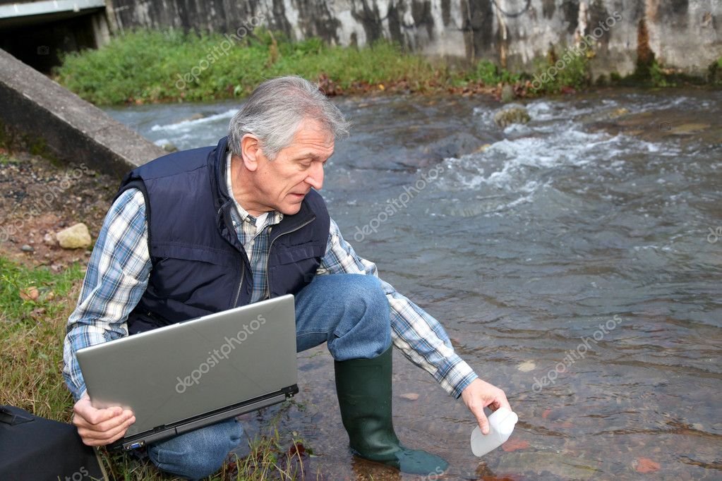 Hydrobiologist testing quality of water