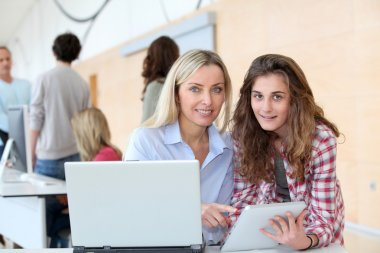 Teacher and teenage girl