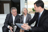 Fotografie Senior couple discussing financial plan with consultant