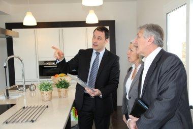 Senior couple choosing new kitchen