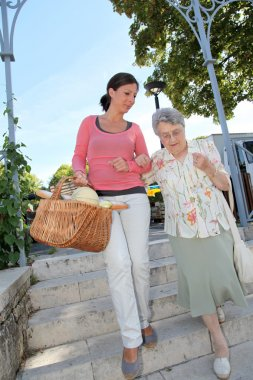 Home carer with elderly person