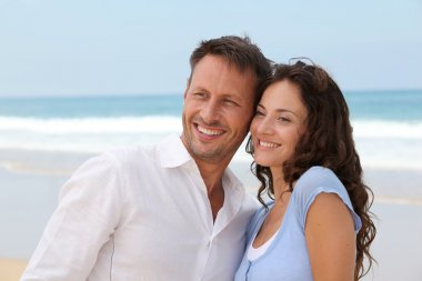 Smiling couple at the beach