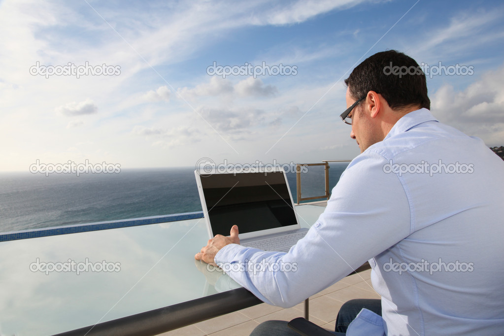 Man working in front of the sea
