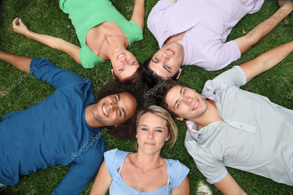 Group of friends laying down in park