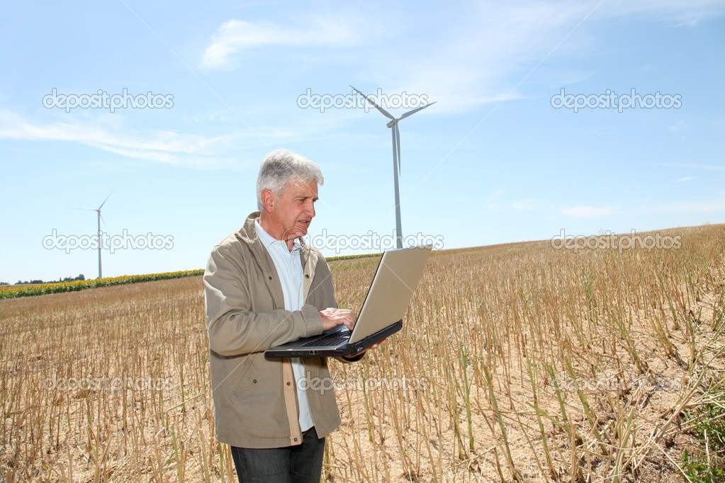 Agronomist with laptop computer