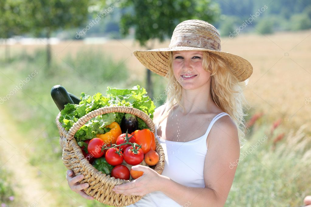 Beautiful woman with basket of vegetables