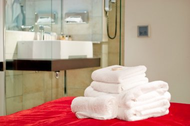 This is a photograph of lying towels on bed in five star hotel