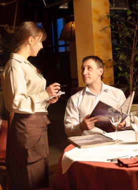 A waiter taking order
