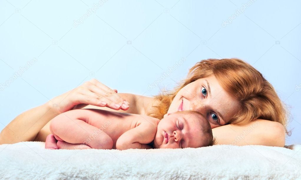 Young happy mother with newborn baby