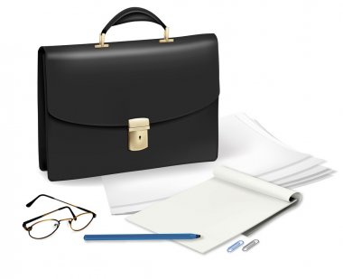 A briefcase and notebook and some office supplies.
