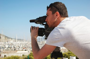 Young cameraman outside
