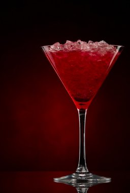Cosmopolitan cocktail drink on a red gradient