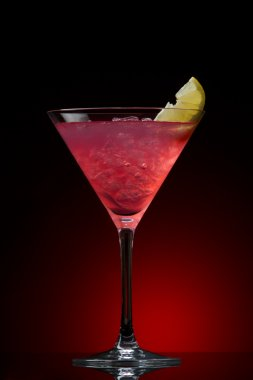 Cosmopolitan cocktail drink on a blue gradient