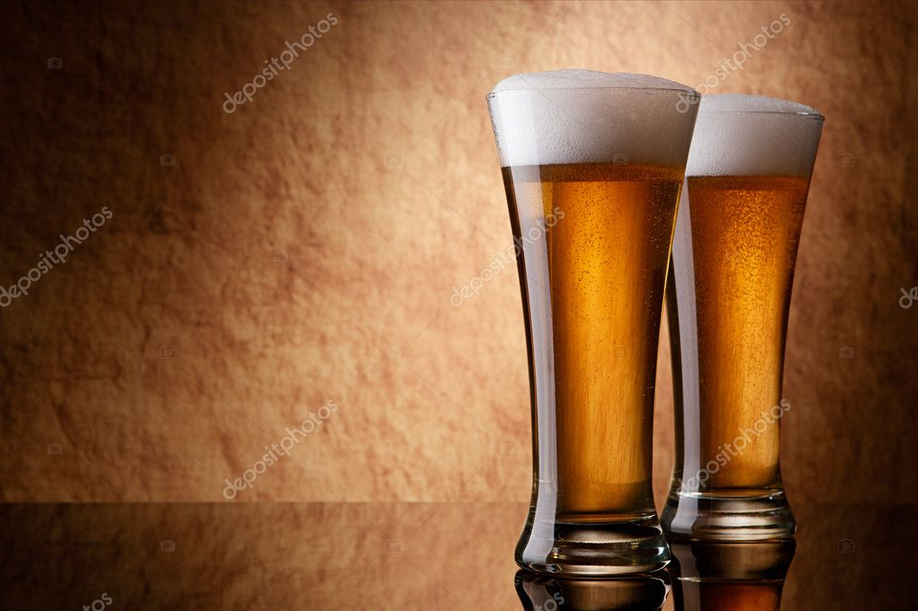 Two glasses of beer on a old stone