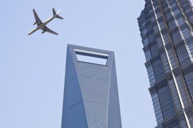Shanghai: plane over modern buildings