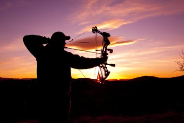Bowhunter at Sunset