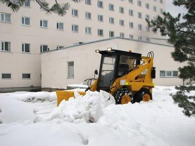 Shoveling the snow.