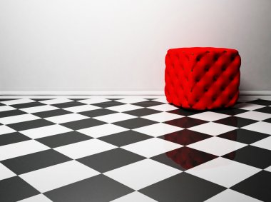 Interior design with a red pouf on the black and white floor