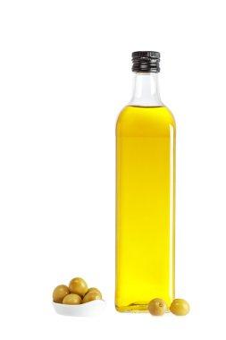 Olive oil bottle and some olives