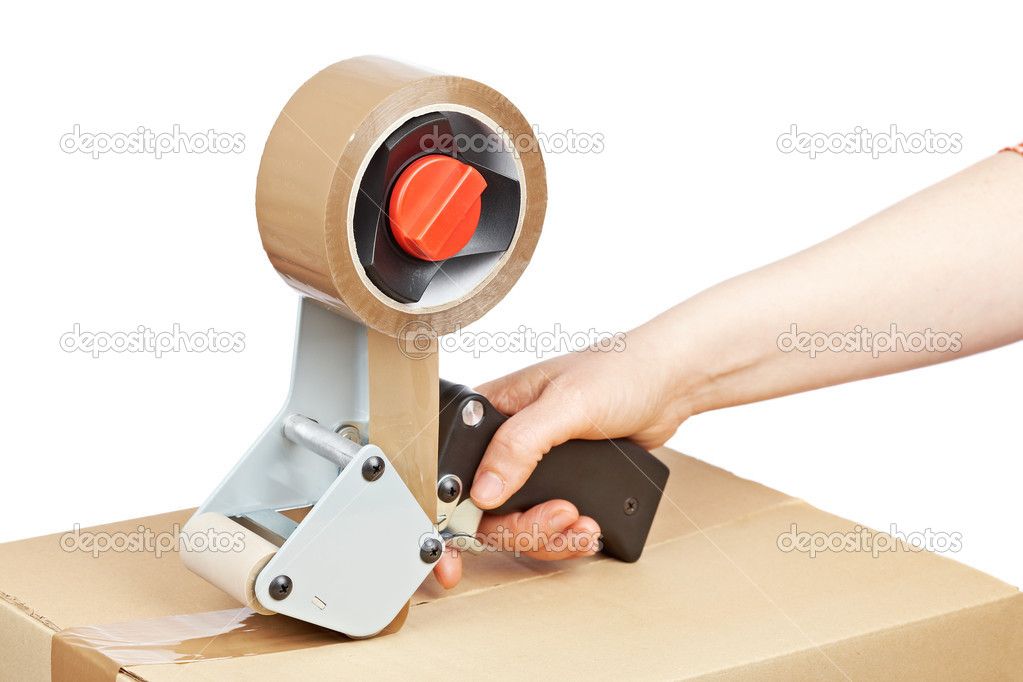 packaging tape dispenser and shipping box u2014 stock photo