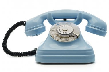 A light blue telephone on white - with clipping path both for telephone and the dial stock vector
