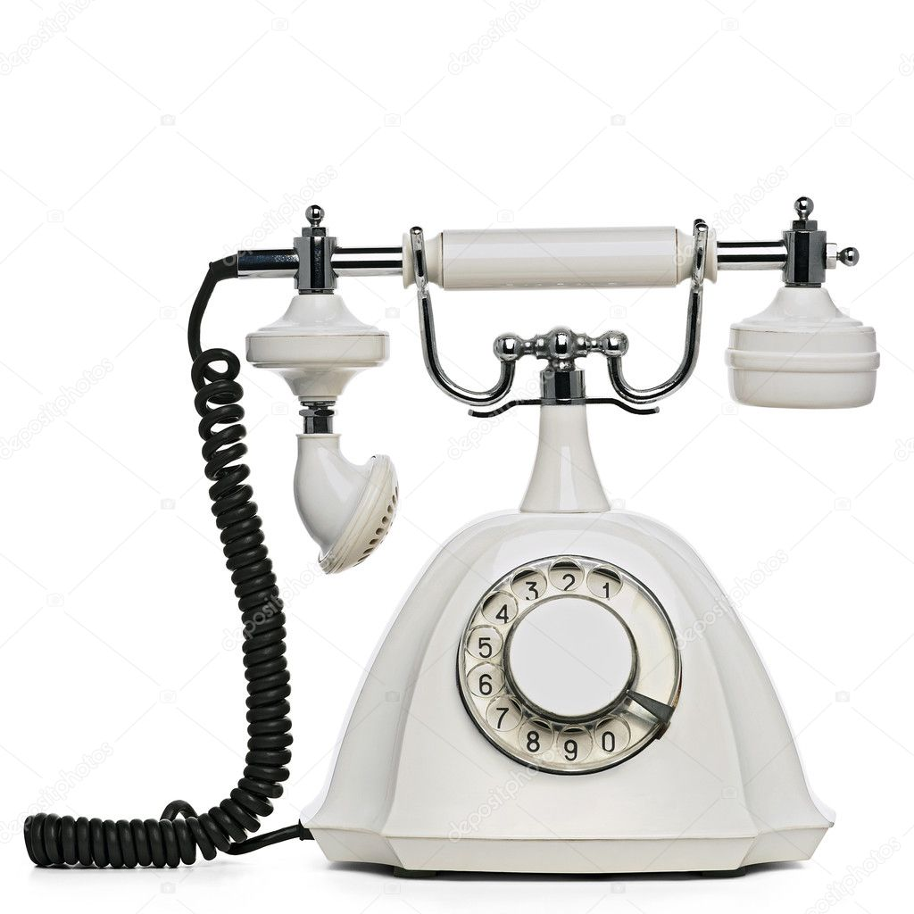 An old white rotary phone on white with clipping path
