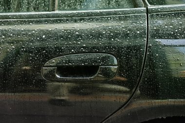 Water drops on car lateral side