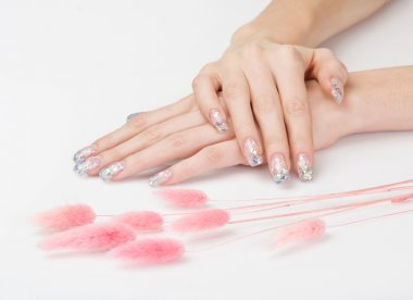 Sparkle manicure and pink decoration