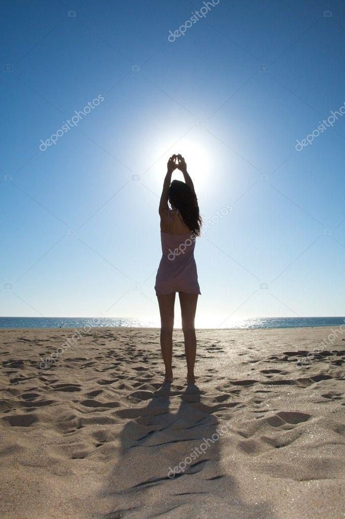 Woman touching the sun