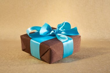 Brown gift box with cyan bow