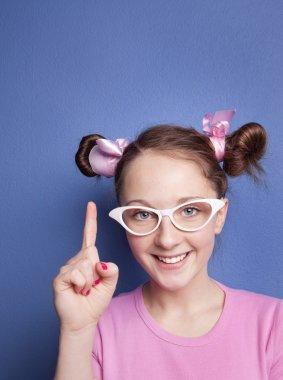 Teenage girl pointing up