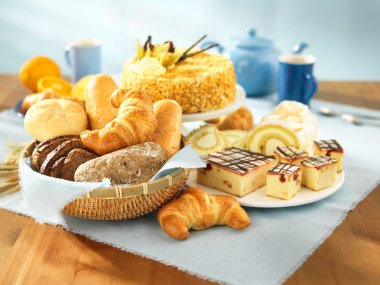 Bread and dessert arrangement on table