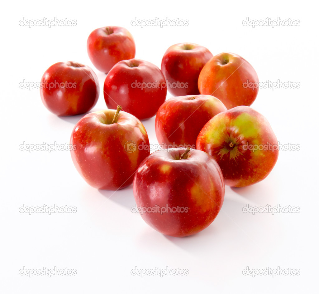 Group of fresh red apples on white background