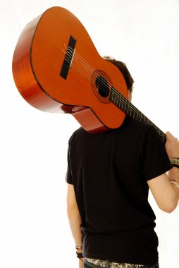 Guitar on his back and away