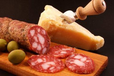 Salami, parmesan cheese, green olives,