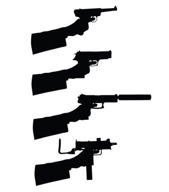 Holding a gun silhouettes