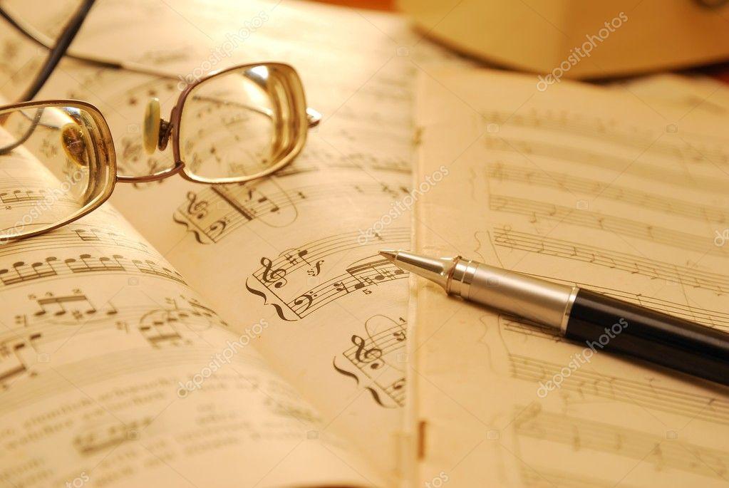 Old music score, manuscript and pen