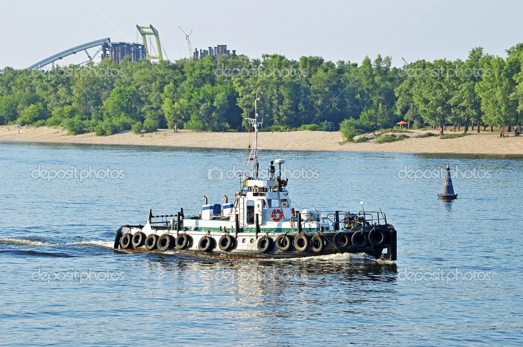 Tugboat assisting a barge
