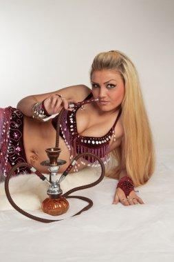 The woman smoking hookah