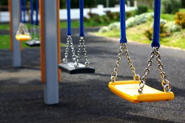 Empty playground swings in a row stock vector