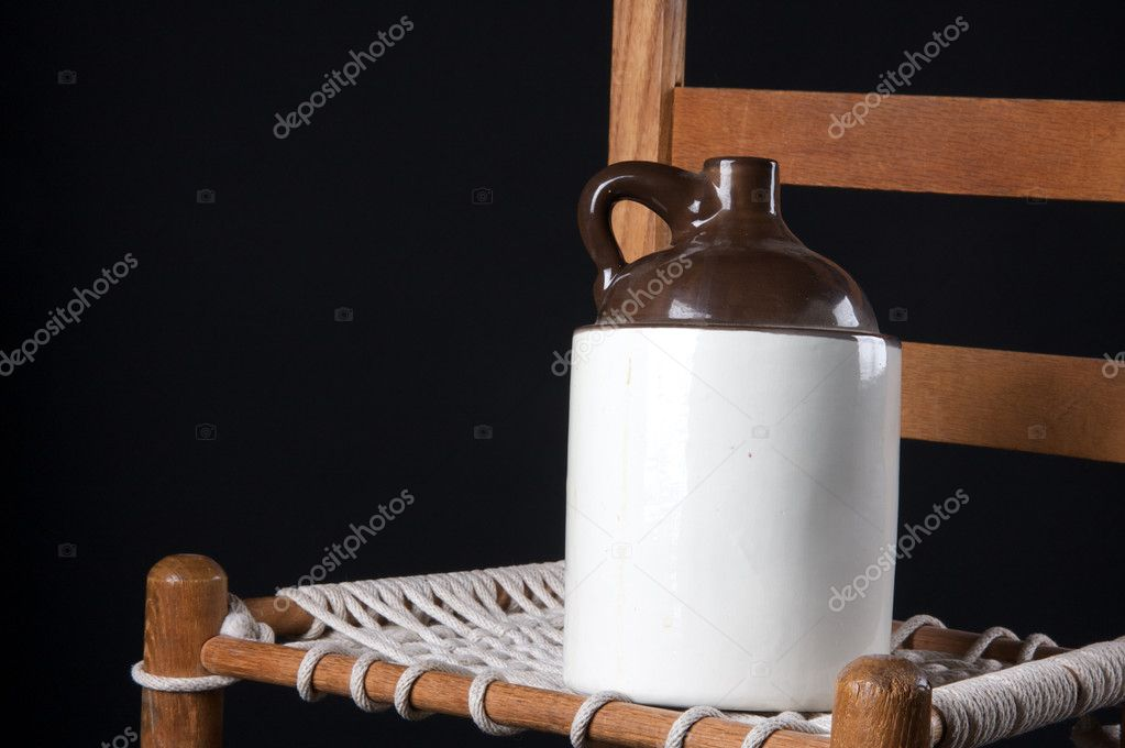 An Old Pottery Ceramic Country Jug And Rope Bottom Chair On A Black  Background In The Horizontal Format With Copy Space. U2014 Photo By Mkm3