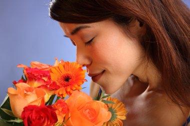 Japanese girl smelling flowers