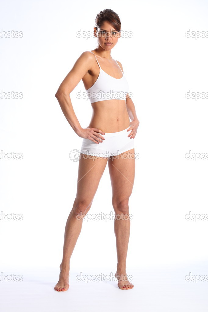 Young Woman With Naked Back Standing By Window Stock Photo