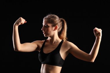 Woman flexing muscles in workout