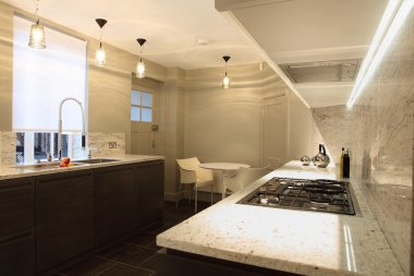 Fitted kitchen with marble counter