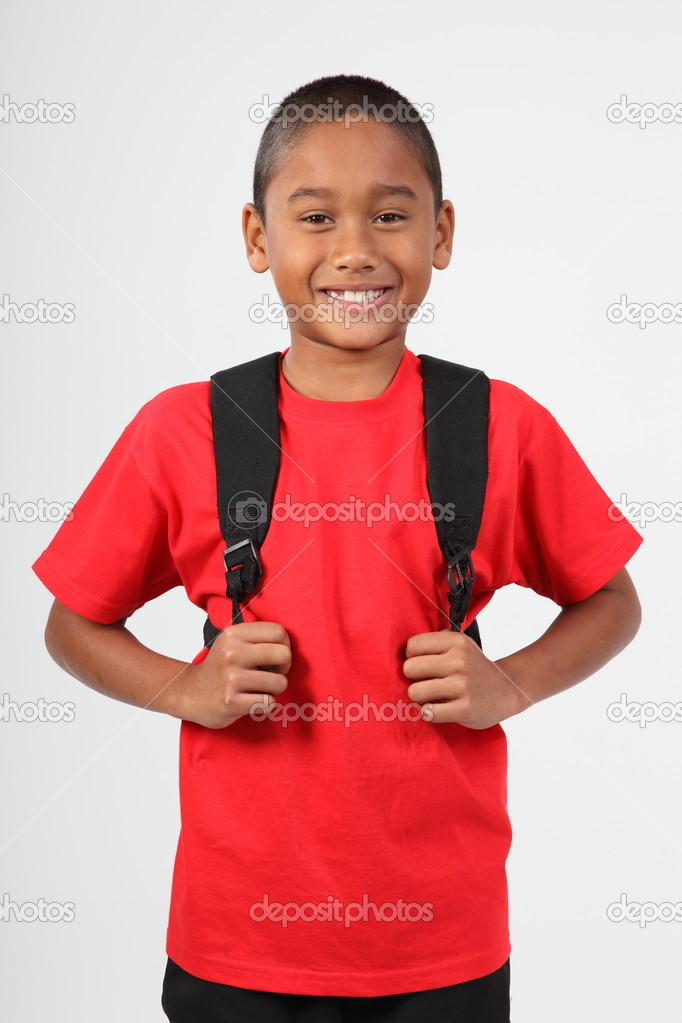 Cheerful smile from young boy 9 wearing school back pack