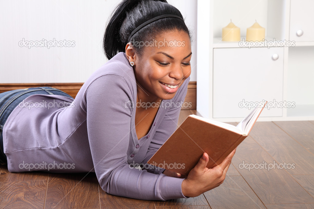 Beautiful Smile From Young Girl Reading A Book  Stock Photo  Darrinahenry 5994669-4429