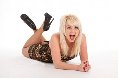 Laughing blonde girl lying on floor
